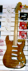 Custom solid 1 piece Flame Maple Strat style